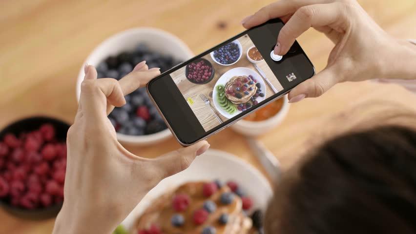 Woman photographing her breakfast in kitchen | Shutterstock HD Video #1014473828
