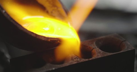 Macro of a goldsmith heating the steel to make a ring. Concept: silver, style, production