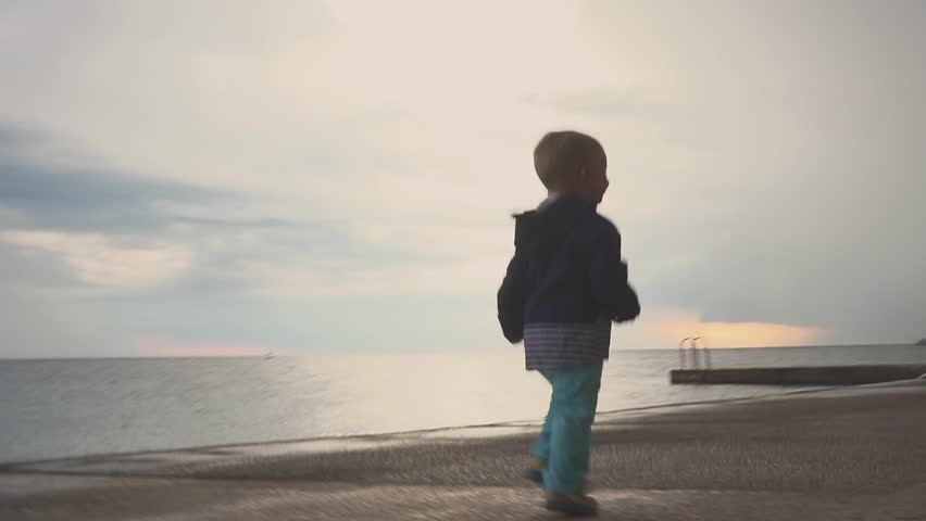 Happy child have fun in the sea beach. Kid play at the ocean. Boy running at sea shore. vacation with kid. Water fun. Family holiday. | Shutterstock HD Video #1014524618