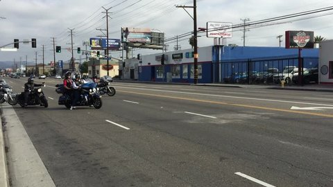 Los Angeles, California, USA, August 2, 2018: Group of bikers riding American motorbikes Harley Davidson