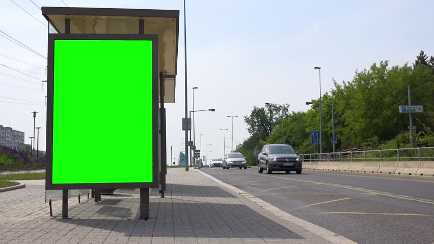 Green screen on the side of a bus stop in an urban area | Shutterstock HD Video #1014563558