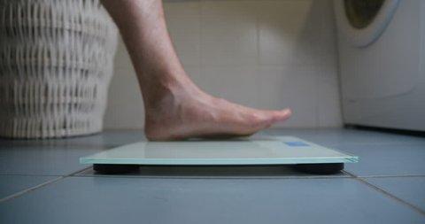 Man feet on weighs