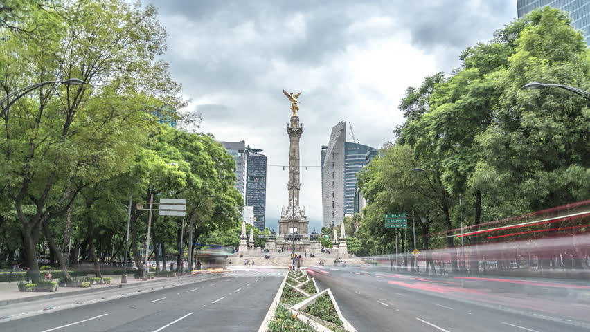 Time lapse of Angel of Independence in Reforma avenue with cloudy sky, Mexico City, CDMX