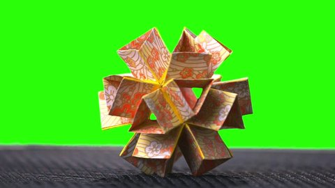 Origami Flower Ball Origami. Ball modular origami ball template. Green hromakey background for keying.