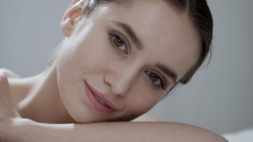 Natural Beauty. Beautiful Woman With Makeup Smiling Closeup | Shutterstock HD Video #1014622478