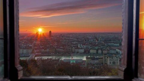 Lyon cityscape aerial view seen through window timelapse night to day