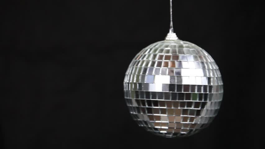 Silver disco-ball is spinning on a black background | Shutterstock HD Video #1014702008