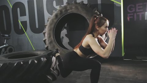Fit woman exercising Bulgarian squats at the gym