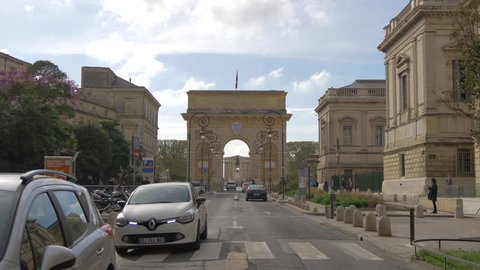Montpellier, France - April, 2017: Driving on Rue Foch, near Porte Du Peyrou.