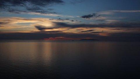 Sun sets near Capraia island. View from Punta Nera, Elba islan, Tuscany, Italy.