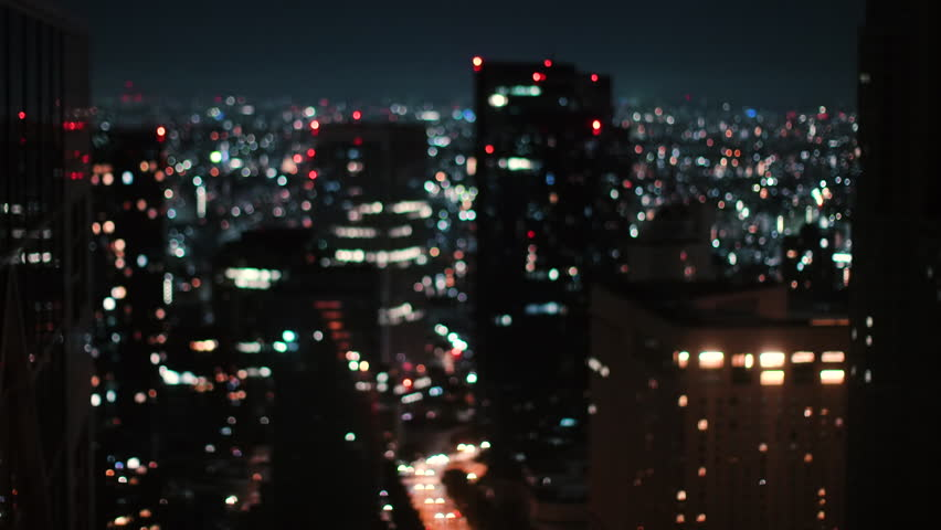 Blurred / Out of Focus / Bokeh City in the Night. Lights Glowing, Skyscrapers, Lamp Posts and City Night Traffic.  | Shutterstock HD Video #1014801338