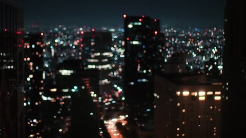 Blurred / Out of Focus / Bokeh City in the Night. Lights Glowing, Skyscrapers, Lamp Posts and City Night Traffic.