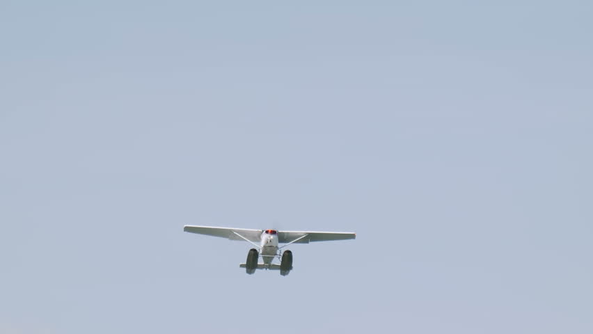 Close up of floatplane flying in blue sky