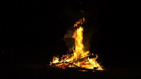 People in folk costumes jumping over a fire, Russian folk traditions