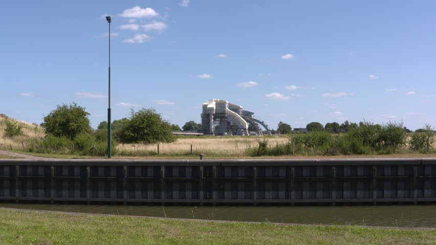 DRIEL, THE NETHERLANDS - JUNE 2018:  Driel weir in scaffolding wrap, behind the lock chamber of the ship lock. The weir ensemble Nederrijn & Lek regulates the distribution of water in the Rhine Delta