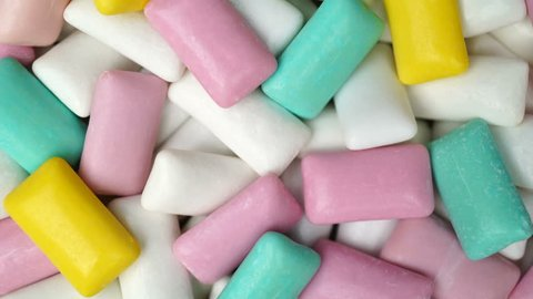 Footage different colors chewing gum rotate texture background