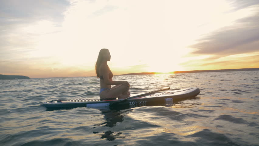 One Woman Floats On Waves Stock Footage Video 100 Royalty Free 1014866548 Shutterstock