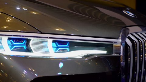 Tangerang, Indonesia - August 08, 2018: Headlamp of BMW Concept X7 iPerformance car with shiny front exterior displayed in Gaikindo Indonesia International Auto Show. Shot in 4k resolution