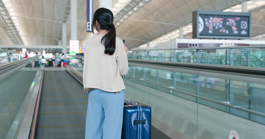 Woman use of mobile phone in the airport | Shutterstock HD Video #1014879628