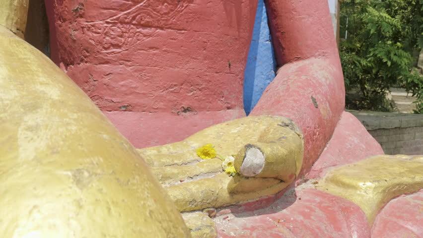 Hands of Buddha statue in the Swayambhunath temple. Kathmandu, Nepal.