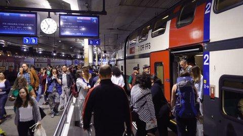 Commuters exiting train at train station platform in Bern, Switzerland - July, 2018