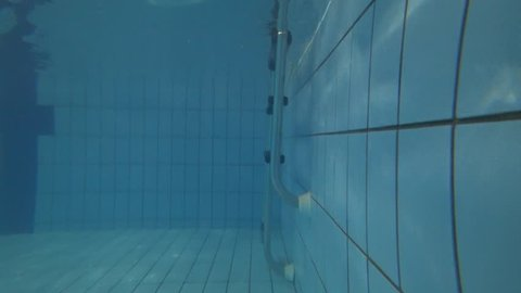 Learning to swim. The view of swimming pool. Under water.  Shooting with gopro. Point of view.