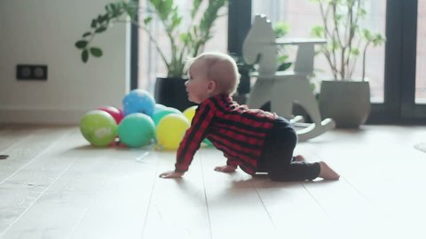 Little baby boy with crawling on the floor at home