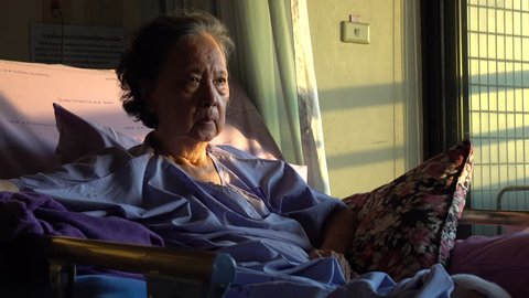 senior woman patient coughing in hospital