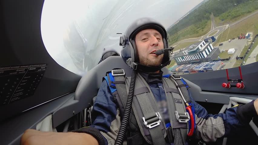 Super extreme flight with loop, male passenger showing thumbs up at cockpit