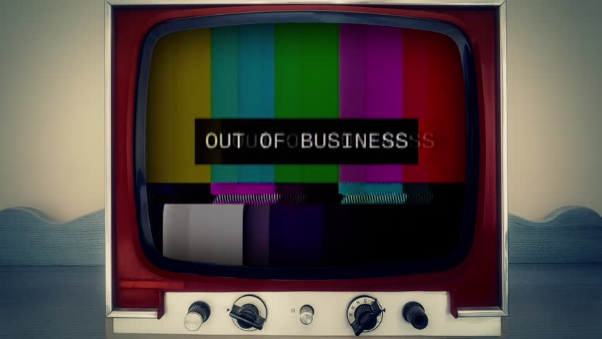 A retro vintage TV showing a noisy signal of SMPTE color bars (a television screen test pattern) with the text Out of business. Analog capture, intentional heavy distortion fx.  | Shutterstock HD Video #1014980158