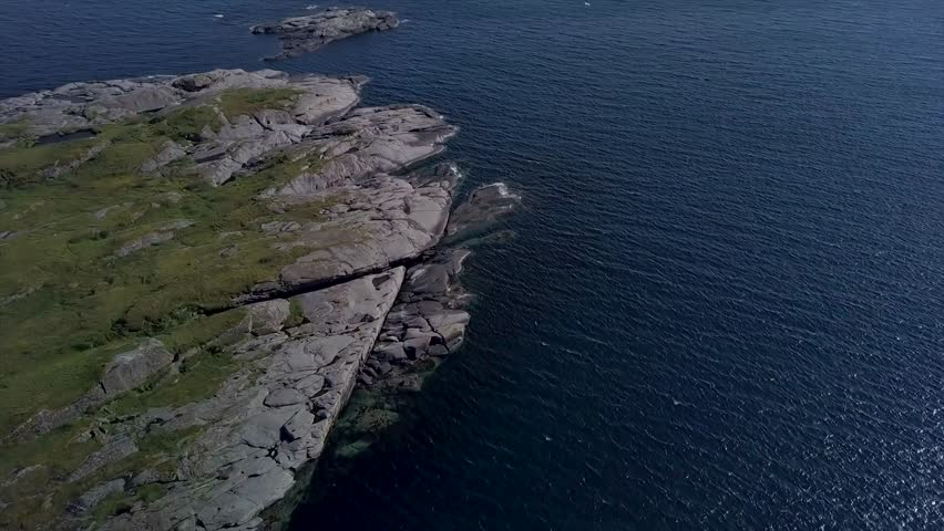 The Lofoten Islands. Flight over the rocky promontory and the sea. The Norwegian Sea. Aerial 4k