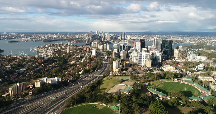 Shift over roof tops of local houses in residential suburbs of North Sydney on Lower North Shore in Sydney facing distant city CBD.