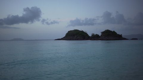 Twilight shot of a small island on the Caribbean ocean for green screen or chroma key. Out of focus or defocused background plate.