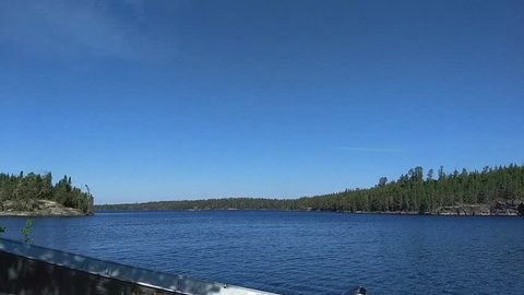 Seaplane on lake in boreal forest.
