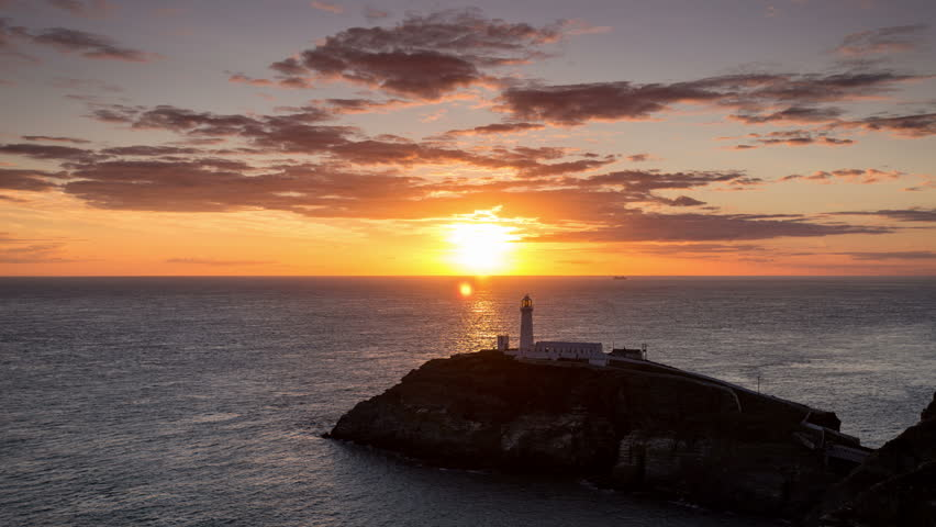 4k time lapse of sunset over South Stack lighthouse, Anglesey coast, North Wales