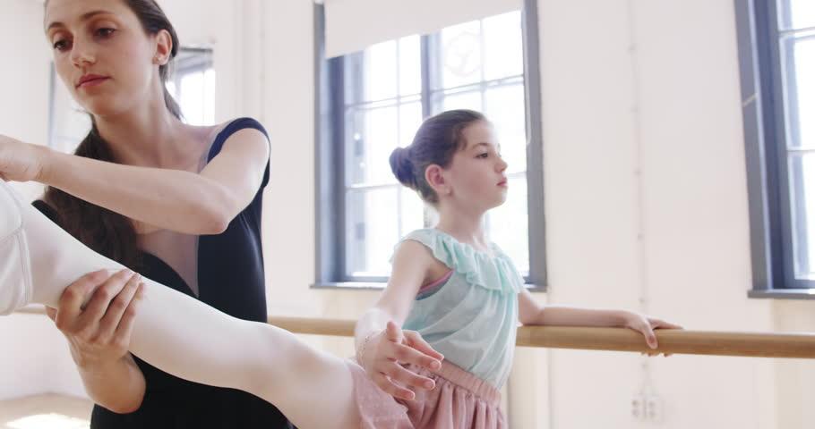 Female Dance Teacher Assisting Children At Ballet Class Learning Childhood Development Slow Motion Red Epic #1015086928