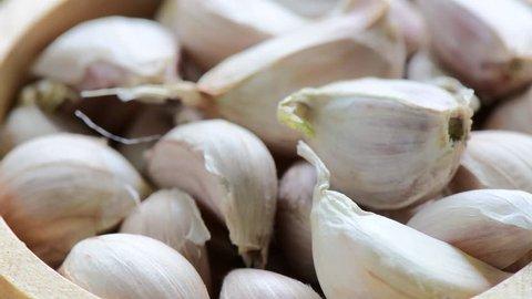 garlic in wood bowl rotation