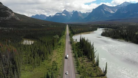 Aerial view of vehicles driving down the iconic Icefields Parkway route between Banff and Jasper National Parks in Alberta, Canada.