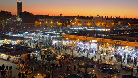 Jamaa el Fna (Jemaa el-Fnaa) in the evening. Marrakesh, Morocco. Zoom out shot