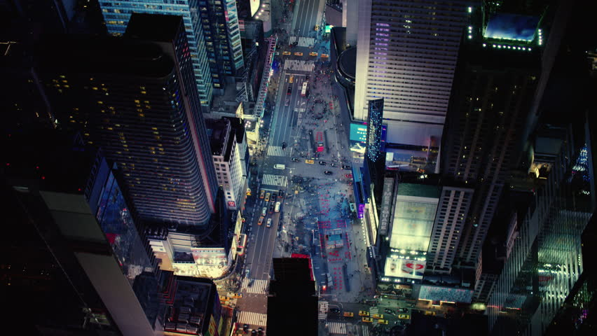 Top-down aerial view of a busy metropolitan city at night. Shot of Times Square in New York. Shot with a RED camera. 4k footage.