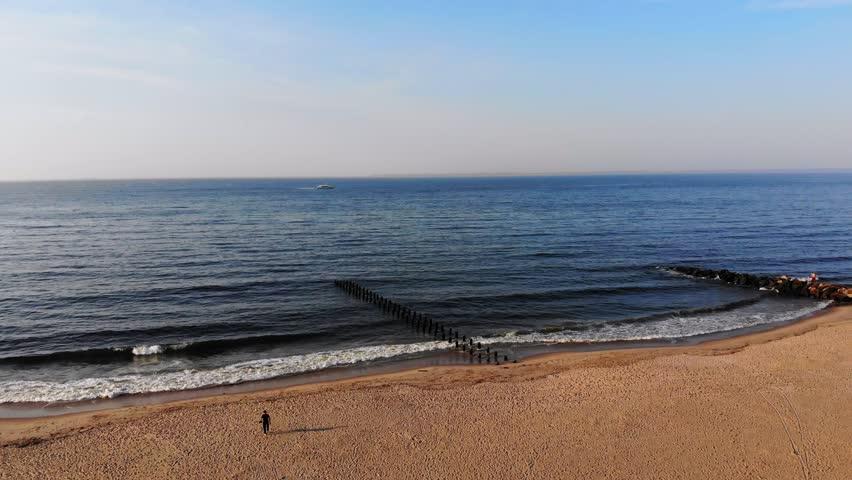 Aerial video of Brooklyn New York at Coney Island Brighton Beach Neighborhood Boardwalk flyover Towards the Ocean over the Beach During sunrise 4k