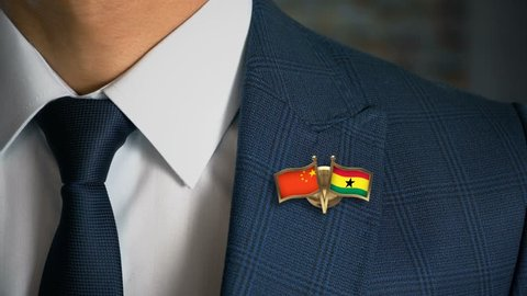 Businessman Walking Towards Camera With Friend Country Flags Pin China - Ghana