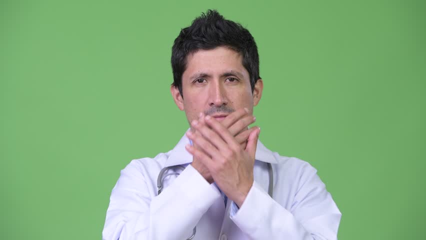 Hispanic man doctor covering mouth as three wise monkeys concept   Shutterstock HD Video #1015300708