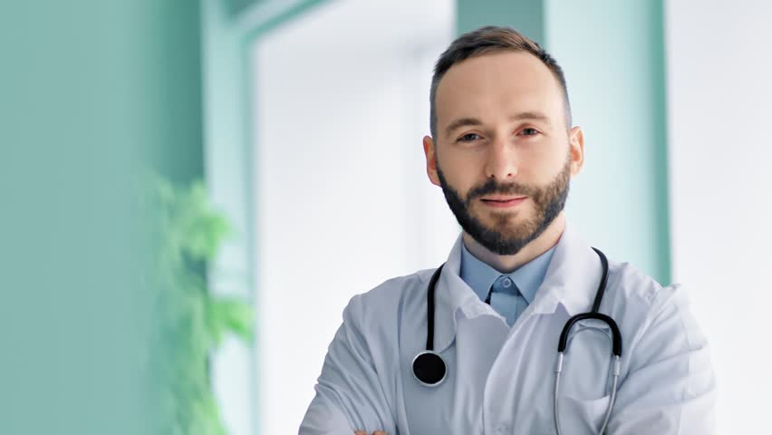 Close-up portrait confident male chief medical officer with beard and white lab coat | Shutterstock HD Video #1015312528