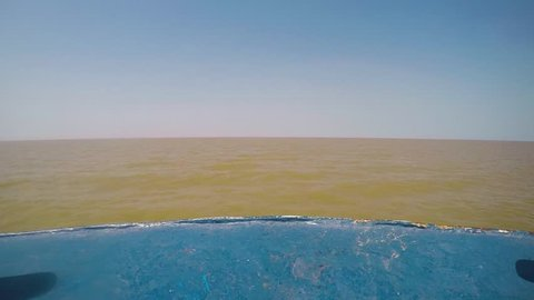 Muddy Brown Tonle Sap lake Cambodia horizon from boat