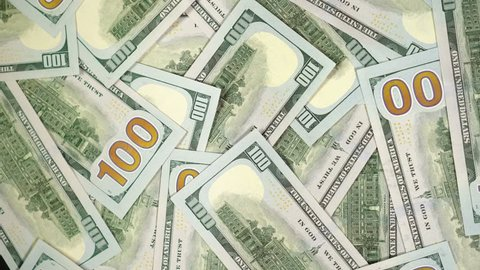 Many dollars are rotating. Spinning background of money. Hape of cash turning. Beautiful rich background with 100 dollar bills. Pile american bucks. You can write your title or logo on our background.