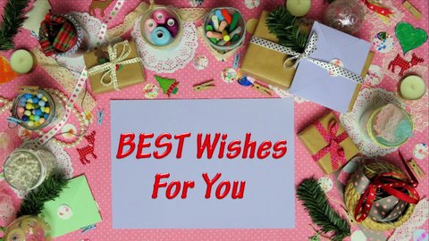 Top view stop motion on the theme of holiday with text Best wishes for you emerging from particles.