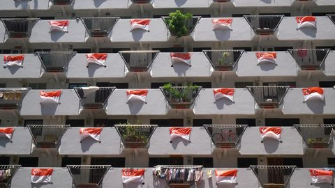 Selegie House/Singapore - 20th Aug 2018: Wide Shot Of The Facade Of A Public Housing Apartment In Singapore Decorated With Wind Blown Singapore Flags