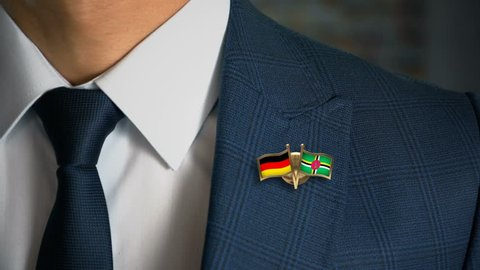 Businessman Walking Towards Camera With Friend Country Flags Pin Germany - Dominica