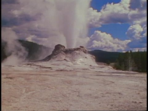 YELLOWSTONE NATIONAL PARK, WYOMING, 1978, Castle Geyser, wide shot, tilt up